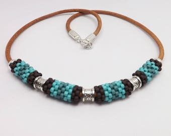 Brown and Turquoise Beaded Bead Necklace on a leather cord Sku: NK1008