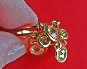 Vintage gold tone  size 7.5 ring with pale yellow rhinestone dangles in great condition, appears unworn