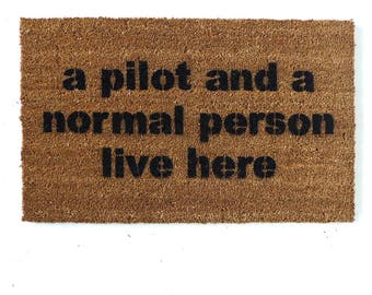 a pilot and a normal person live here funny aviation custom hand painted doormat