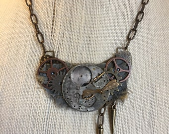Steampunk bib statement necklace with watch parts, fibers and gears