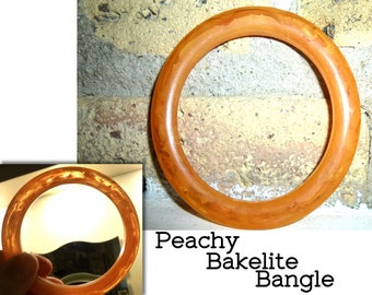 "Bakelite Bangle Bracelet. Peach with Transparent Swirls. Tested & Guaranteed. 1940s USA - 1/4"" Wide."