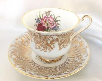 Vintage Paragon England pale blue Tea Cup and Saucer