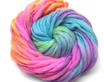 Handspun rainbow yarn, 50 yards and 3.25 ounces, 93 grams, spun super chunky, thick and thin in merino wool