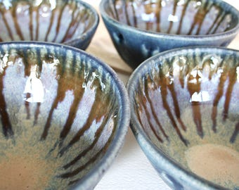 Set of four rustic stoneware bowls. Hand made, hand painted, black, navy blue, celadon, gray, sunburst, starburst, nesting, stacking.