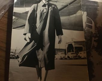 Golden age of flying ! Braniff stewardess 40's 50's? Maybe a photo cut down. 4 x 6.5 approx. no writing on back. Neat okd stewardess view.
