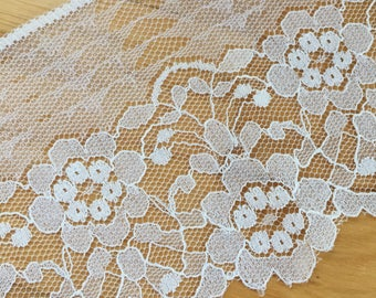 """White Flowers and Leaves Flat Lace trim 4"""" wide. Poly/cotton netting with scallop pattern on edge."""