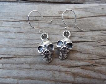 Skull earrings handmade in sterling silver