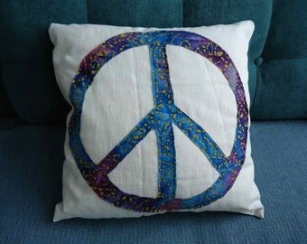Peace throw pillow with blue and purple batik fabric