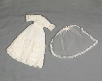 1960s  Wedding Dress for Barbie including the veil, Lined bodice and skirt, Pearl crown attached to the hip length veil, 5 layers of lace