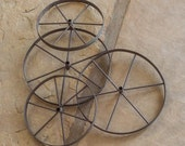 Four Small Rusted Iron Wheels for Crafts or Wall Decor