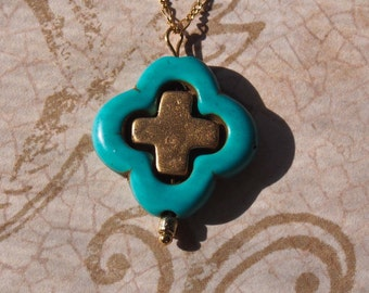 Turquoise quatrefoil with gold cross necklace