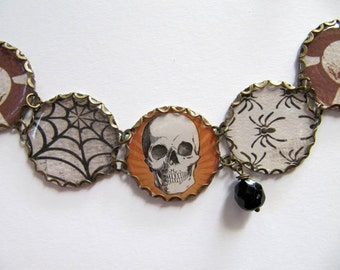 Spider and Skull Charm Bracelet in Brown, Orange, White and Black, Skeleton Jewelry, Recycled Paper, Resin Domes, Glass Beads, Adjustable