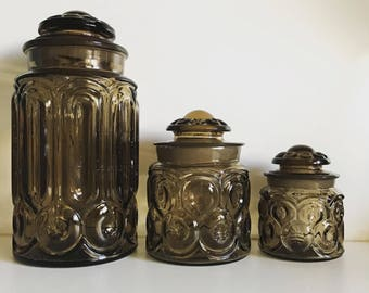 L E Smith Moon and Stars Glass Canisters