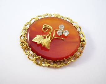Victorian era gold tone brooch with carnelian stone and vines