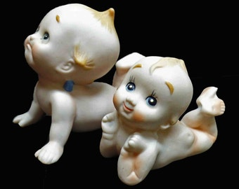 Vintage Kewpie Figurines set of 2 bisque statues looking up