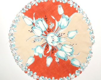 Round Handkerchief, Robins Egg / Aqua Blue Rose Bouquet In the Center, Blue Flowers on Scalloped Edges, Back Ground is Taupe and Terracotta