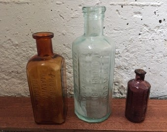 Three Vintage Medicine Bottles