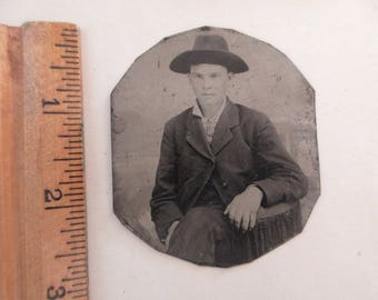 antique tintype - man with hat and fat fingers