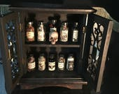 Wicked Devil Apothecary Cabinet with Antique Bottles of Real Herbs