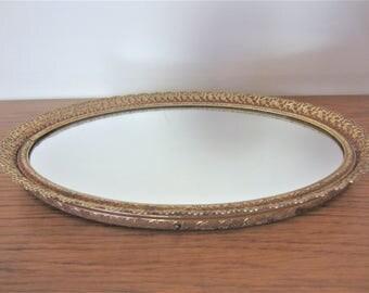 Vintage gold oval mirror dresser caddie.  Gold filigree dresser caddie.