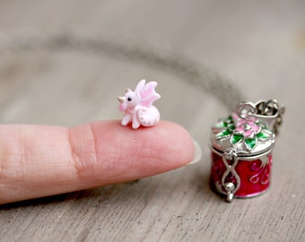 Tiny miniature pink dragon in a locket charm necklace