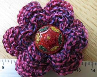 Irish crochet flower brooch in pink wool with vintage red glass button centre