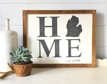 Framed HOME sign. Frame made from upcycled barn wood.