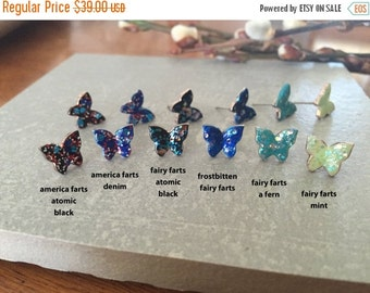 70% OFF Frostbitten Fairy FARTS...  glitter butterfly studs << awesomeness on your ear >> proceeds donated to Humane Society