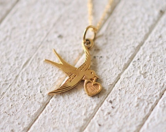 Vintage 9k yellow gold SWALLOW charm necklace .vintage bird charm . love token