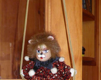 Lion Clown Marionette on wooden swing