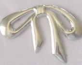 "Large Sterling Bow Brooch.  Taxco, Mexico.  TT-23.  This Pin looks like a Tied Bow with Loops and Ends Hanging Gracefully.  3"" W x 2-1/4"" H."