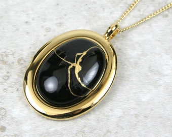 Kintsugi (kintsukuroi) black onyx stone cabochon with gold repair in a gold plated setting on gold chain - OOAK
