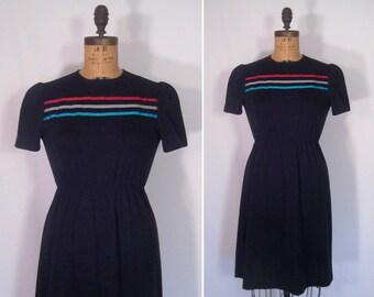 1970s black day dress • 70s noir ribbon trim dress • vintage speak low dress