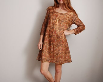 60s small paisley print gold psychedelic short mini holiday party empire waist long sleeve dress womens vintage clothing