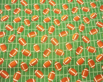 "FOOTBALLS on GREEN  Backround 100%  Cotton  fabric  One 1/2 piece 18"" x 44"""