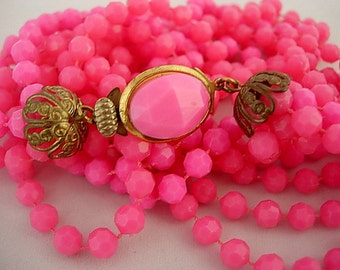 Groovy Hot Pink Vintage Faceted Lucite or Plastic Beaded 6 Strand Necklace Gorgeous Ornate Cabochon and Filigree Clasp Gold Tone Metal Retro