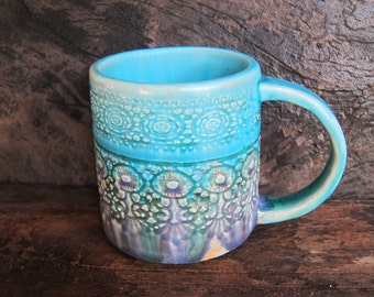 A beautiful turquoise & violet, sweet lace imprint handmade ceramic mug