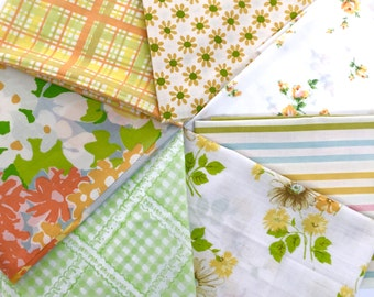 Seven vintage sheet fat quarters, yellow, orange, green, and blue