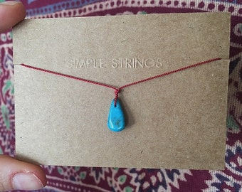 Turquoise Stone on Red Silk