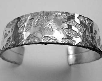 aluminum open cuff bracelet, 12mm width, aluminum chemically etched and hand-forged, with polished finish.