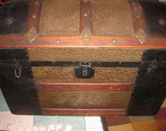 "Local Pick Up DOME TOP TRUNK Steamer Trunk Wood And Metal The Metal Is A Hammered Leaf Design Trunk Is 34"" Long 18 3/4"" Wide 24 1/2"" High"
