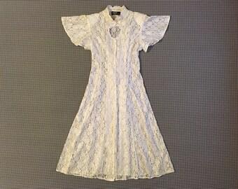 1990's, sheer, white lace, dress, with keyhole neck, fits Women size S-Medium/Large