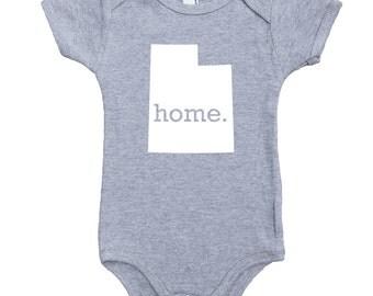 Homeland Tees Utah Home Unisex Baby Bodysuit