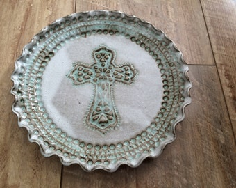 Handmade pottery plate with cross