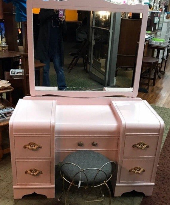 Pink waterfall vanity and mirror