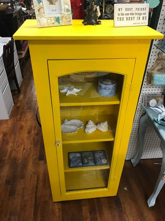 Yellow display cabinet
