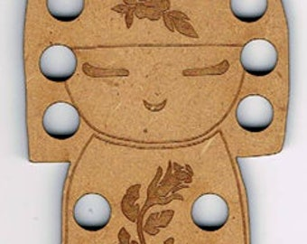 Japanese Doll (Kokeshi) Thread (Floss) Holder, made from MDF.  16 colours can be sorted onto this thread organiser.  Made in France.