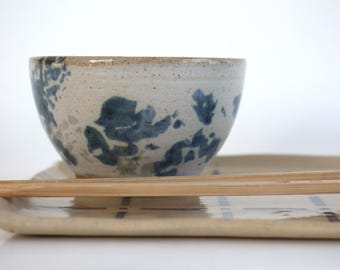 small tea bowl in blue and white ceramics , handmade