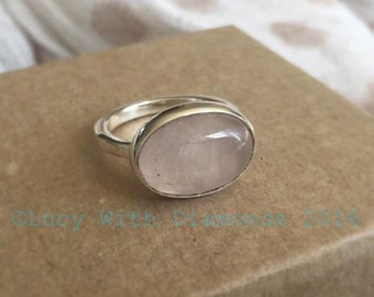 Large oval pink rose quartz hammered ring