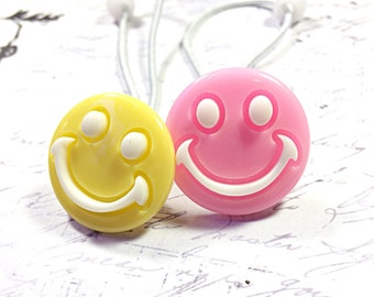 Pink and yellow smiley face ponytail holders - hair ties